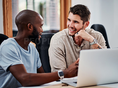 Buy stock photo Cropped shot of two handsome young businessmen working together in the office