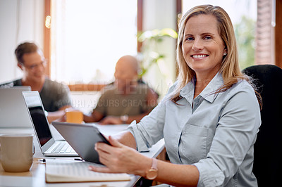 Buy stock photo Portrait of a mature businesswoman using a digital tablet in an office