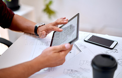Buy stock photo Closeup shot of an unrecognisable architect using a digital tablet in an office