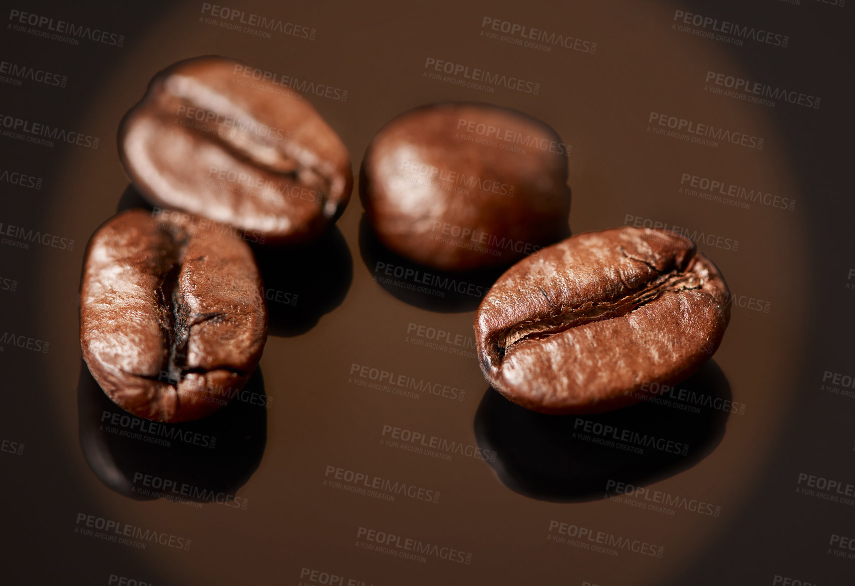 Buy stock photo Studio shot of coffee beans against a brown background