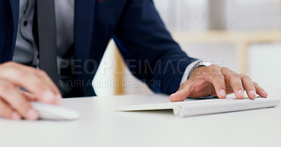 Buy stock photo Closeup shot of an unrecognisable businessman using a computer keyboard and mouse in an office