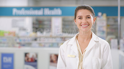 Buy stock photo Portrait of a confident young woman working in a pharmacy