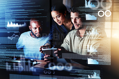 Buy stock photo Shot of a group of programmers using a digital tablet while working together on a computer code at night