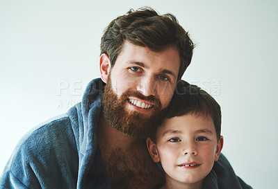 Buy stock photo Portrait of a young man and his adorable son going through their grooming morning routine