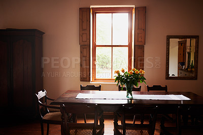 Buy stock photo Shot of a bunch of flowers in a vase on a table at home