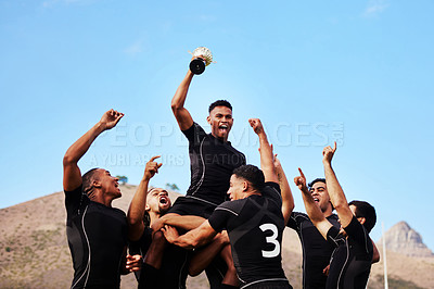 Buy stock photo Shot of a group of young rugby players celebrating after winning a game