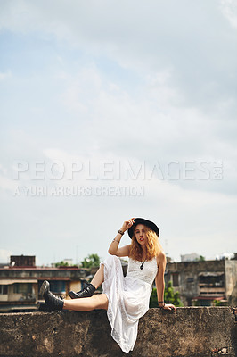 Buy stock photo Shot of a beautiful young woman out on a rooftop in the city