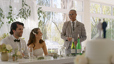 Buy stock photo Shot of a best man standing and delivering his speech for a young couple during their wedding reception