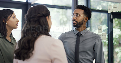 Buy stock photo Shot of three businesspeople having a discussion in an office