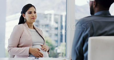 Buy stock photo Cropped shot of a woman touching her pregnant belly while sitting in a meeting