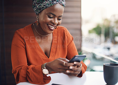 Buy stock photo Cropped shot of an attractive businesswoman sending a text while working in her office