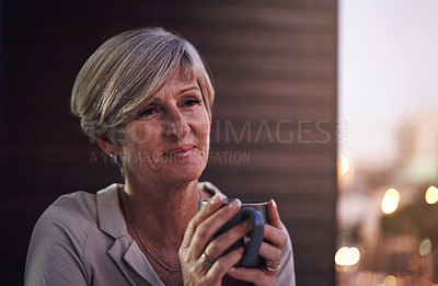 Buy stock photo Cropped shot of an attractive mature businesswoman enjoying a coffee while working in her office