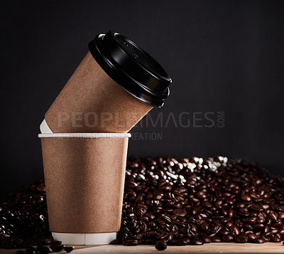 Buy stock photo Closeup shot of two paper cups with coffee beans in the background