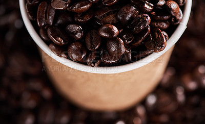 Buy stock photo Closeup shot of a paper cup filled with coffee beans