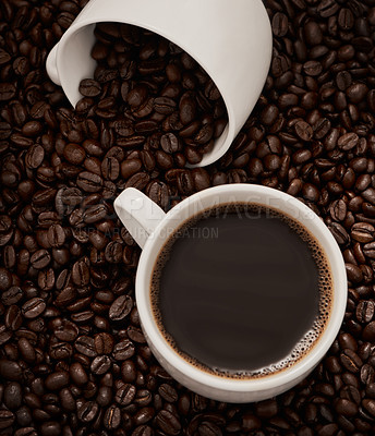 Buy stock photo Closeup shot of two cups of coffee surrounded by coffee beans