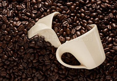 Buy stock photo Closeup shot of two cups on a pile of coffee beans