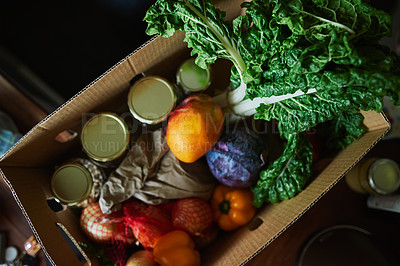 Buy stock photo High angle shot of a box full of fresh produce on a kitchen counter at home