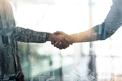 Buy stock photo Cropped shot of two businessmen shaking hands superimposed on a city background