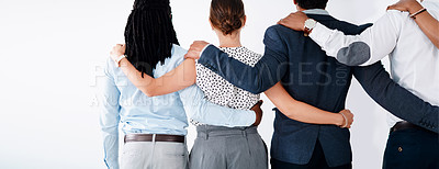 Buy stock photo Rearview shot of a group of businesspeople standing together with their arms around each other