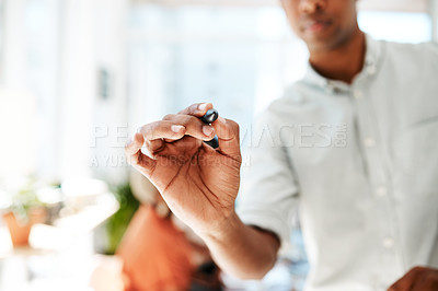 Buy stock photo Closeup shot of an unrecognisable businessman holding a marker in an office