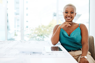 Buy stock photo Portrait of a young woman going over blueprints in a modern office