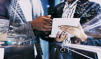 Buy stock photo Superimposed shot of two businesspeople using a digital tablet together in an office