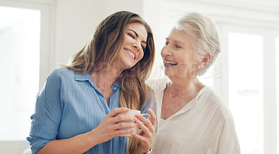 Buy stock photo Shot of a young woman and her senior mom spending quality time together at home