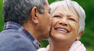 Buy stock photo Shot of a happy senior couple spending a romantic day in the park