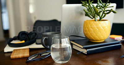 Buy stock photo Closeup shot of various items on a table in a workspace at home