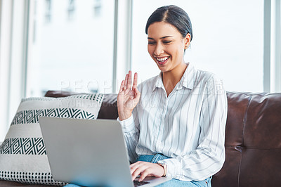 Buy stock photo Shot of a young woman using a digital tablet to have a web conference at home