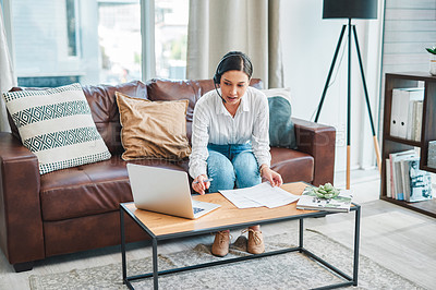 Buy stock photo Shot of a young woman using a laptop and headset while working from home