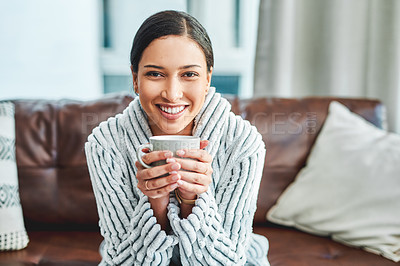 Buy stock photo Portrait of a beautiful young woman enjoying a coffee break on the sofa at home