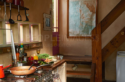 Buy stock photo Cropped shot of a meal being prepared in a rustic kitchen