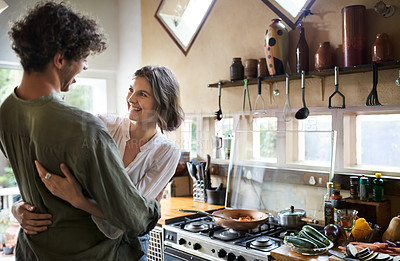 Buy stock photo Cropped shot of an affectionate couple standing in the kitchen at home