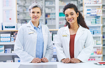 Buy stock photo Portrait of two confident pharmacists working in a chemist