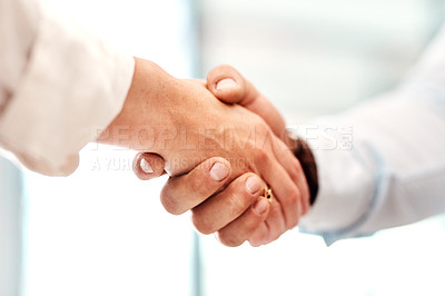 Buy stock photo Closeup shot of two unrecognisable businesspeople shaking hands