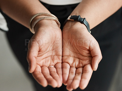 Buy stock photo Closeup shot of an unrecognisable businesswoman standing with her hands cupped together