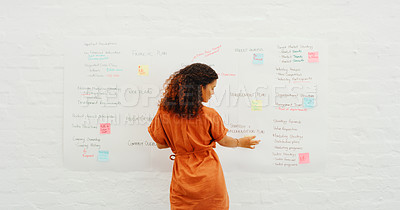 Buy stock photo Rearview shot of a young businesswoman having a brainstorming session in a modern office