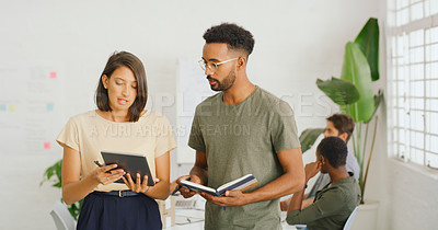 Buy stock photo Shot of a young businesswoman and businessman using a digital tablet in a modern office
