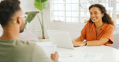 Buy stock photo Shot of a young businesswoman and businessman having a meeting in a modern office