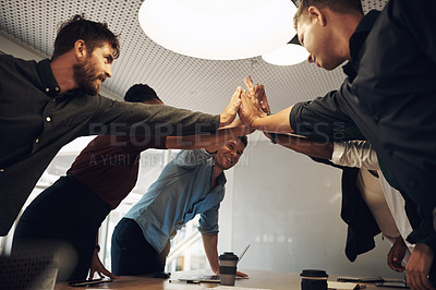 Buy stock photo Cropped shot of a group of business colleagues high fiving during a meeting in the boardroom