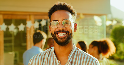 Buy stock photo Portrait of a young man having a get together with friends in the garden at home