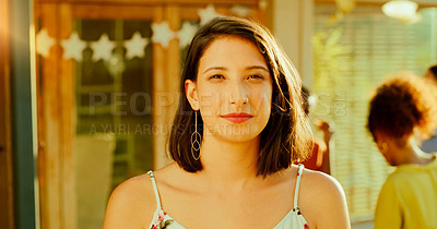 Buy stock photo Portrait of a young woman having a get together with friends in the garden at home