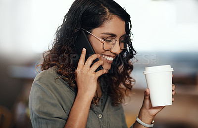 Buy stock photo Shot of a young woman using a smartphone and having coffee in a cafe
