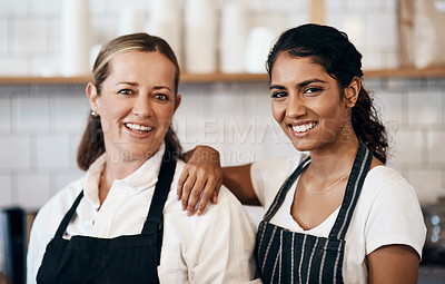 Buy stock photo Portrait of two confident women working together at a cafe