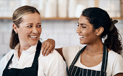 Buy stock photo Shot of two confident women working together at a cafe