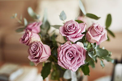 Buy stock photo Shot of a bunch of pink roses at home