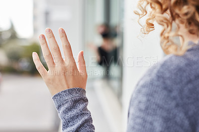 Buy stock photo Shot of two women waving at each other from their apartment's