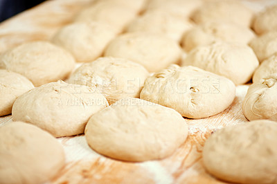 Buy stock photo Cropped shot of a bunch of rolls on a baking tray ready to be placed into the oven