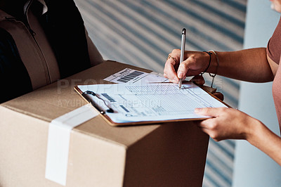 Buy stock photo Closeup shot of an unrecognisable woman signing for a delivery from the courier